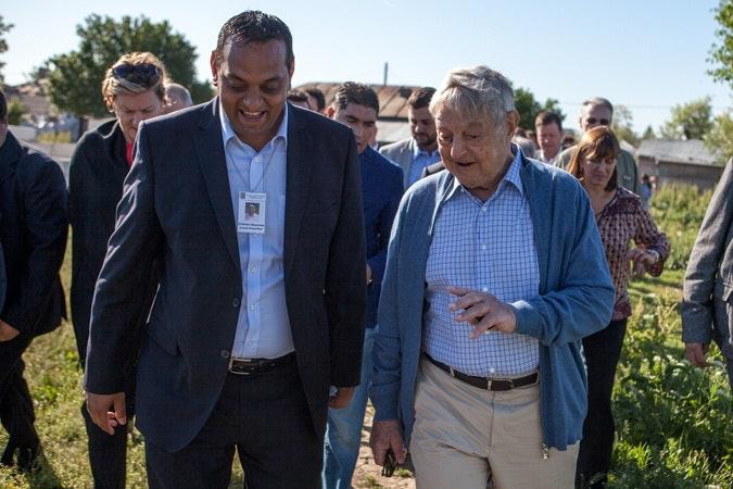 Two men walk together.