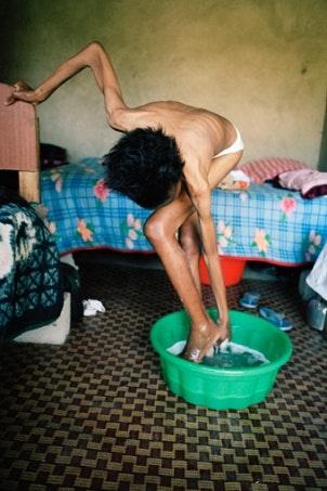 A woman bathing.