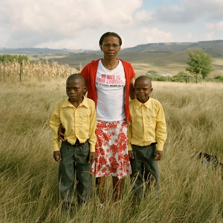 A woman with two boys.