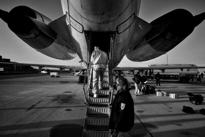 A man boarding a plane