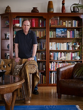 A man standing behind a chair