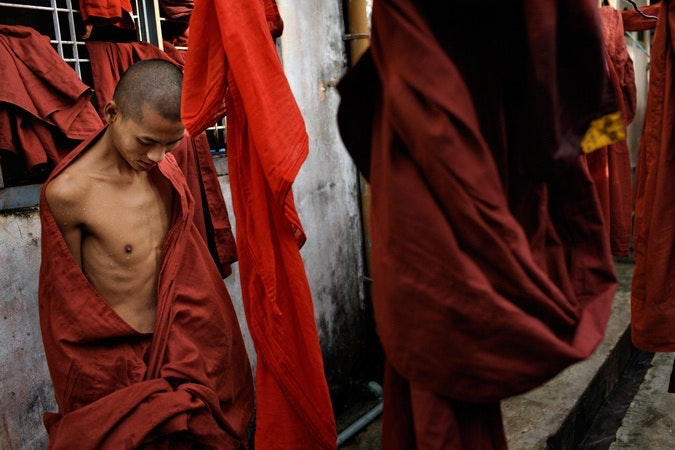 A man draped in red cloth