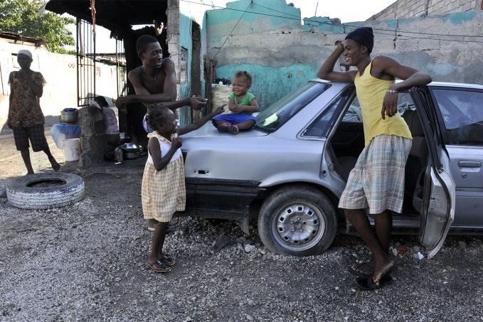People near a car