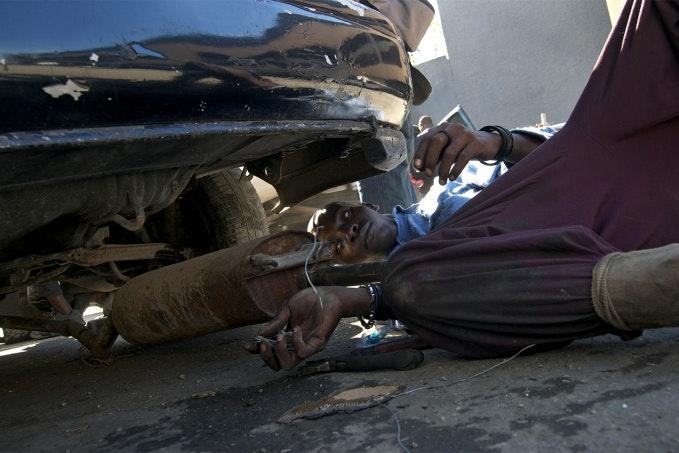 Man works on a car