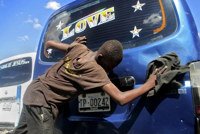 Boy cleans car