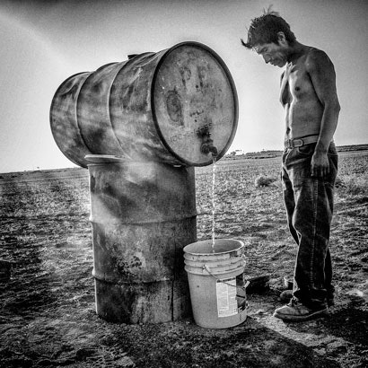 A man and water drum