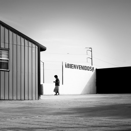 Woman walks into building