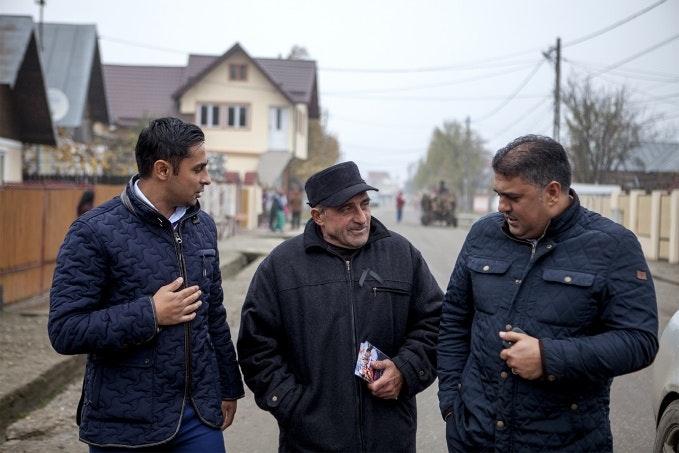 Men talk on the street