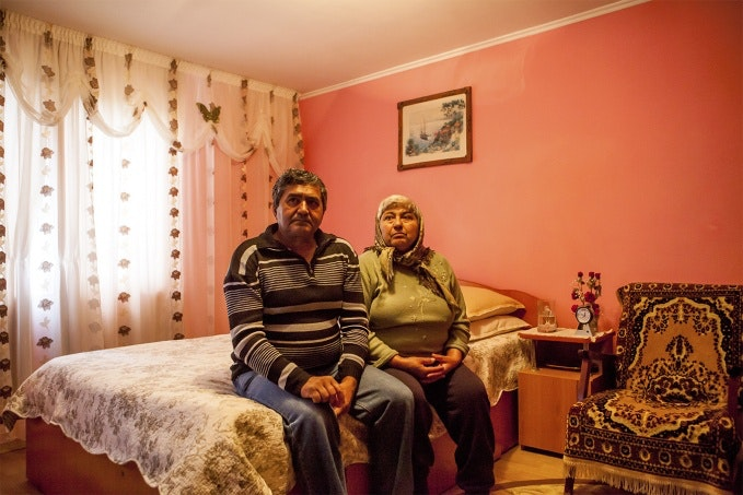 Couple sits in bedroom