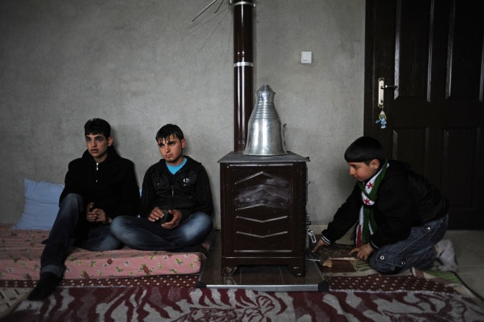 Young men next to a stove
