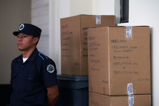 A police officer standing in front of boxes
