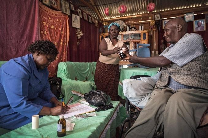 A patient receiving medicine in his home