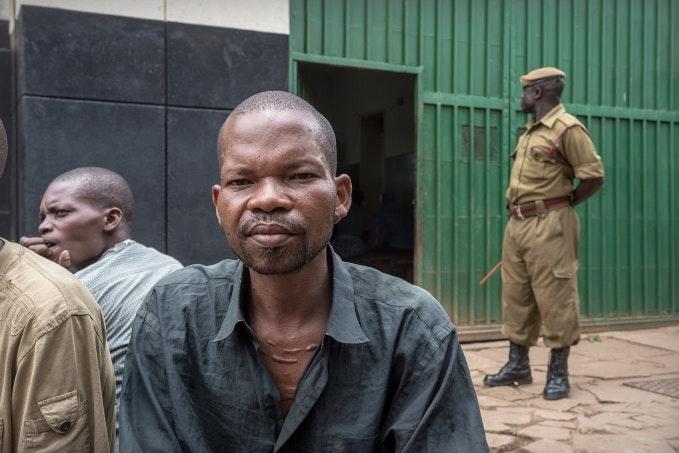 A man sitting in a prison yard