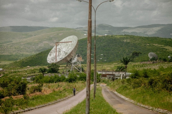 Aging satellite dishes in a landscape