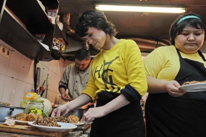 Staff prepare plates in a kitchen