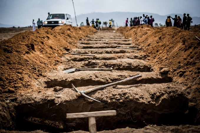 Rows of newly dug graves