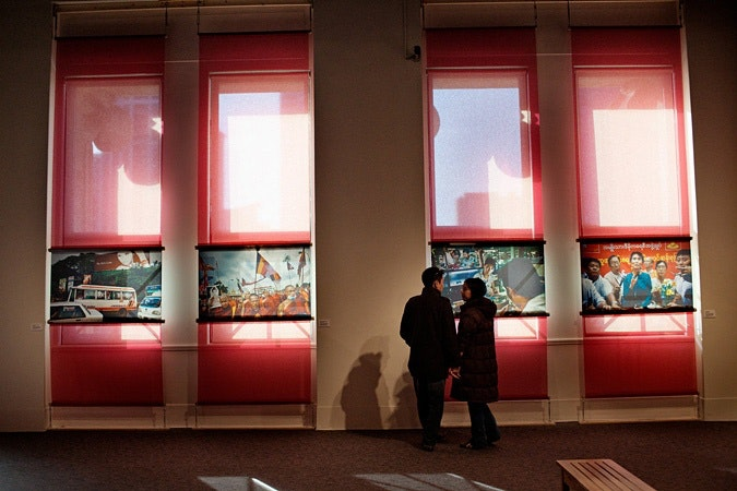 Two people looking at images at exhibit