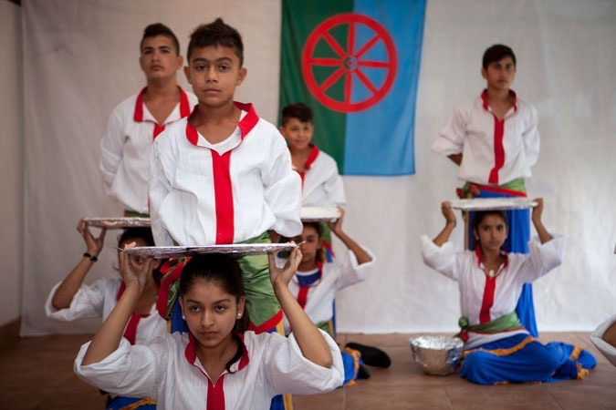 Roma children performing a play.