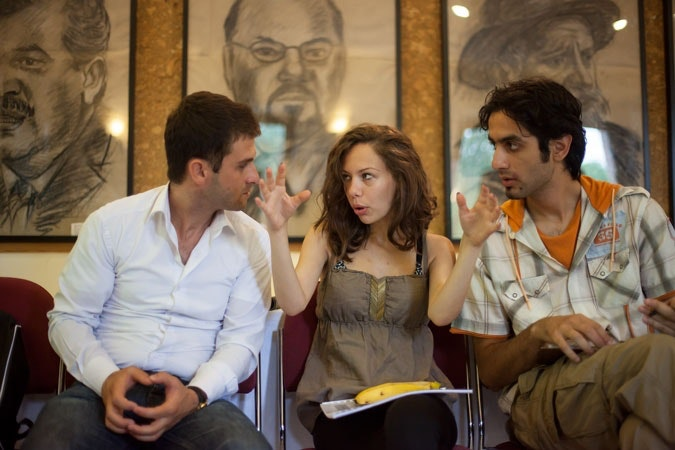 Female Barvalipe participant speaking to two men.
