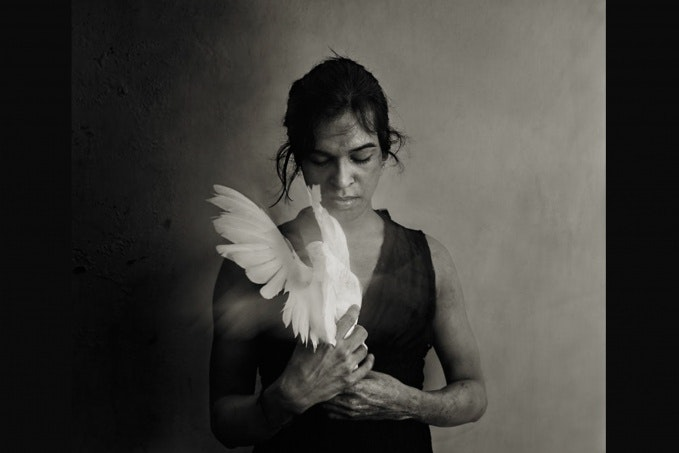 Woman holding a dove