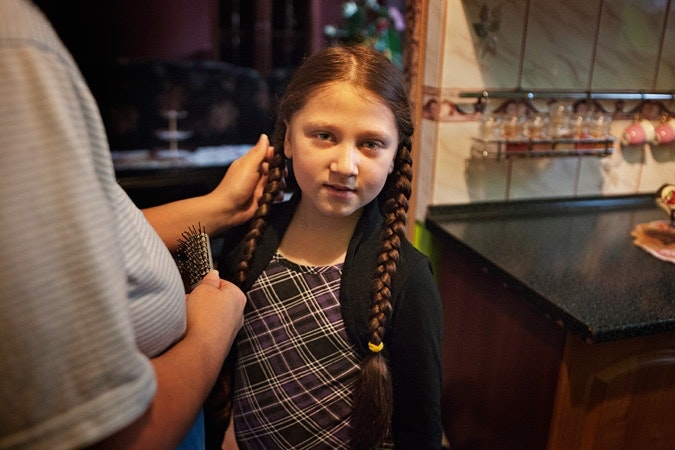 Girl getting her hair combed