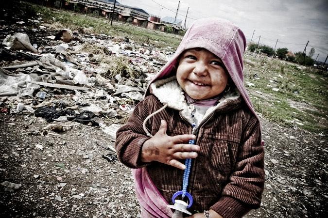 A boy mugs for the camera in the Roma settlement near Gjakova.