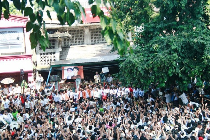 Large crowd cheering Daw Aung San Suu Kyi