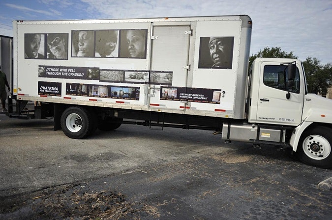 Truck with Those Who Fell Through the Cracks exhibition photographs on side