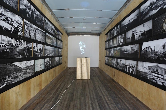 Those Who Fell Through the Cracks exhibition photographs displayed on walls