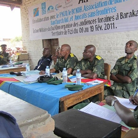 Gender court military judges sitting at a table