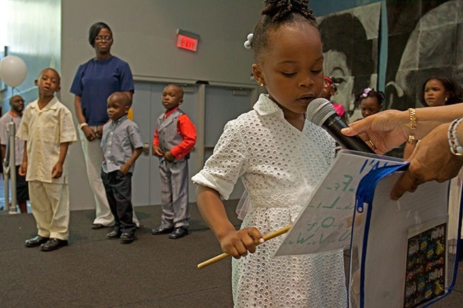 Young girl with a microphone.