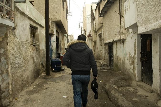 Man walking down narrow street