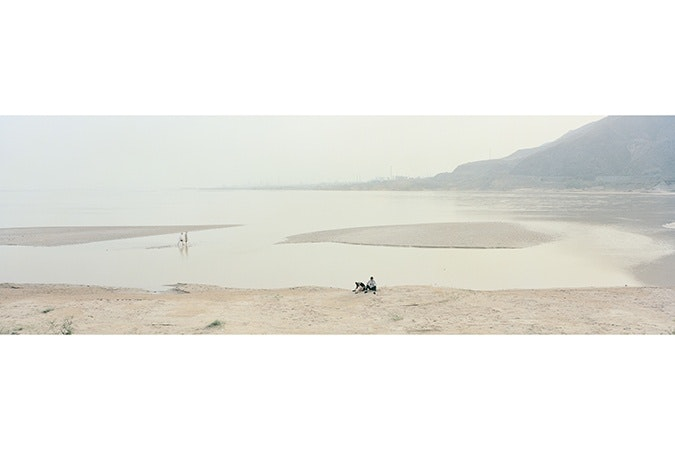 A couple on the banks of the Yellow River