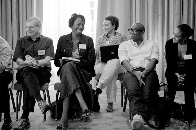 Group at leadership retreat sitting and smiling