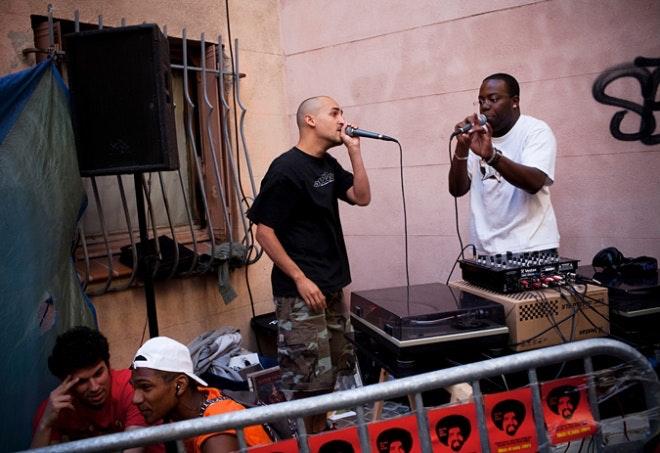 Tow men singing into microphones