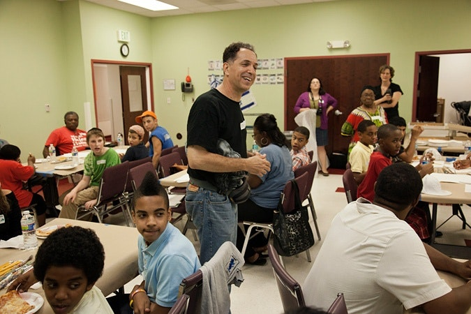 Jay Wolf Schlossberg-Cohen in a classroom with kids