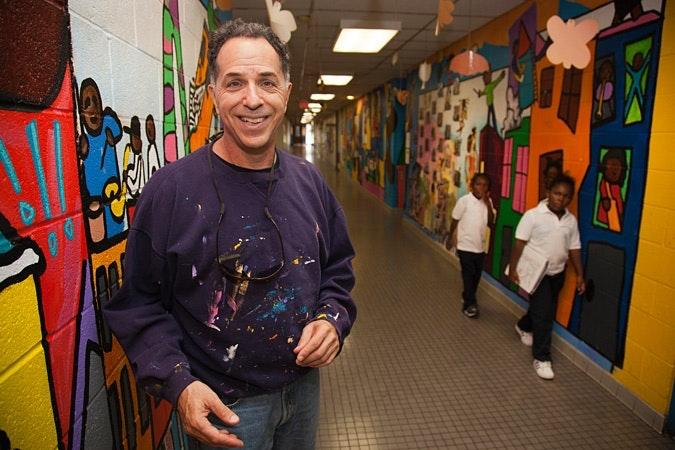 Jay Wolf Schlossberg-Cohen standing in a hallway