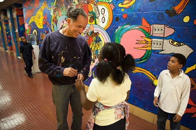 Jay Wolf Schlossberg-Cohen talking to kids in hallway