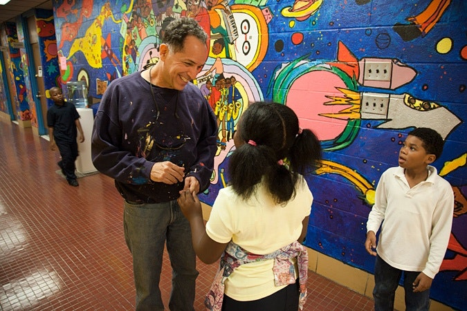 Jay Wolf Schlossberg-Cohen talking to kids in hallway