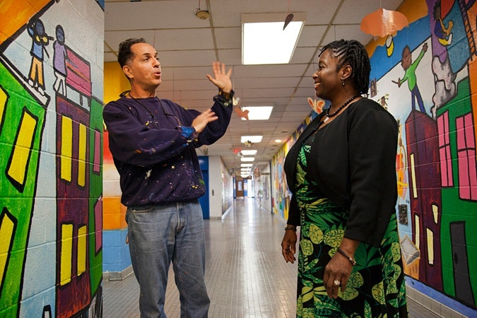 Jay Wolf Schlossberg-Cohen talking to Cynthia Cunningham Evans in hallway