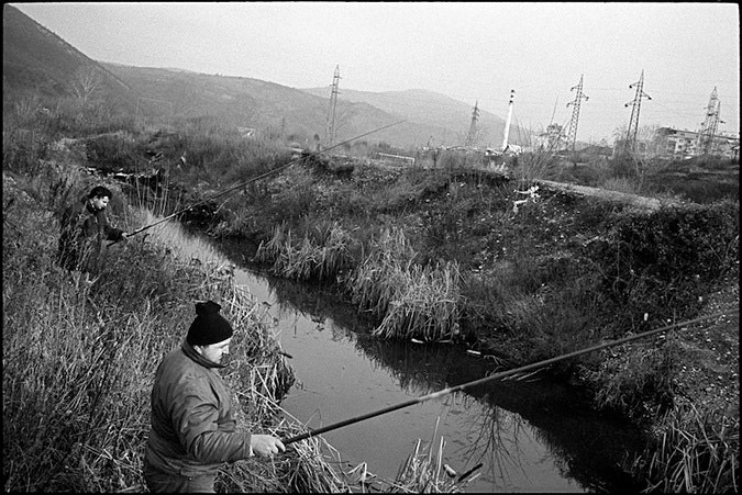 Two men fishing in a river