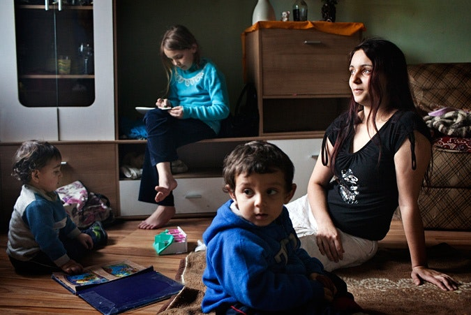 Veronika Šindelářová sitting on the floor with her sons