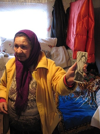 Woman holds up picture
