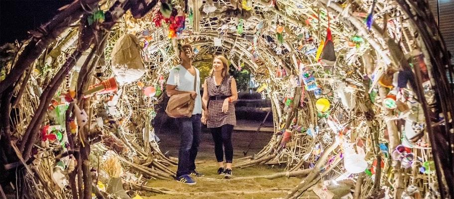 Two people inside an art installation